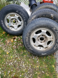 Chevy 6 bolt winter rims and tires and center caps 250$