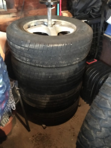 Set of four P215/70R15 and set of two P205/70R15 - All w Rims