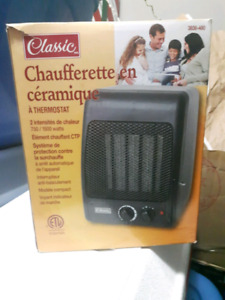 Still in the box electric portable heater