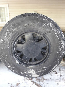 (4) 235/75/15 GM 5 Bolt Factory Rims with Tires.
