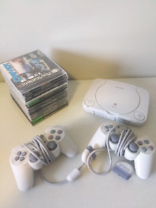 Sony PlayStation 1 with 2 Controllers and 12 Games