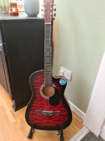 Full size acoustic guitar complete with stand, plectrums and como