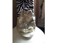 Roberto calvalli gold duffle handbag new