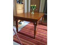 Solid Pine table sits 8