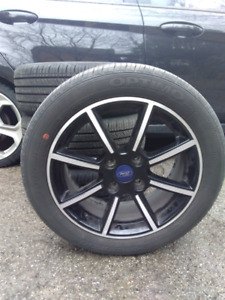 Ford Fiesta aluminum 8 spoke gloss black rims with summer tires