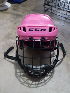 Girls Pink CCM youth helmet with cage