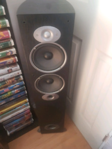Polk Audio Tower speakers with covers