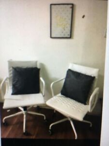 Two white leather office chairs