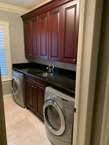 Laundry Room Cupboards and Granite Countertop