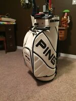 Golf Staff Bag and various golf clubs for sale.