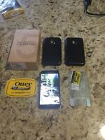 Samsung s5 with 2 otter boxes and glass screen protector