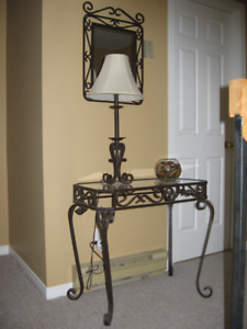 Black wrought iron glass table, matching lamp and mirror $120.
