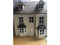 Beautiful dolls house and lots of furniture and dolls