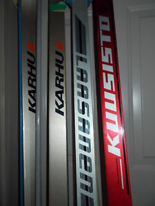 4 PAIRS OF CROSS COUNTRY SKIS, SHOES AND POLES. FOR SALE!