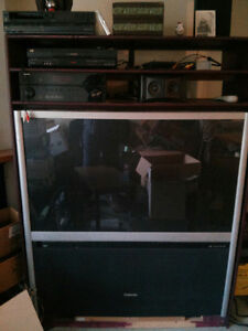 """51"""" Rear Projection TV and surrounding stand for audio accessori"""