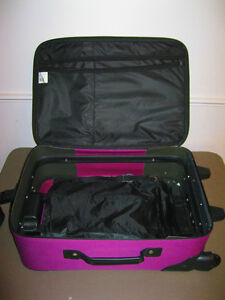 Purple/Pink suitcase for sale
