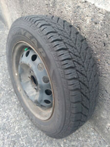 Four 185/65 R14 Winter Tires on 4 Stud Rims - Used 1 Winter