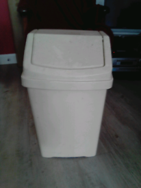 Cream plastic bin
