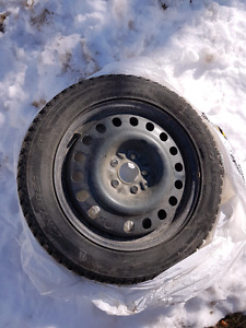"FOUR 215/55/17"" winter studded tires on rims"