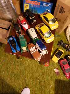 Diecast cars and some piggy banks