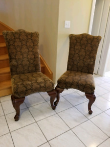 Solid wood high back padded chairs.