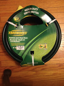 Brand new rubber and vinyl garden hose by Yardworks