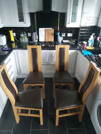 Set of 4 Solid Oak and leather dining chairs