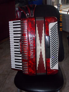 accordion Universal to trade for high end guitar