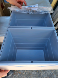 Bottom mounted kitchen bins