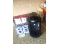Bosch coffee machine, with 1 1/2 packs of Cadbury hot chocolate.