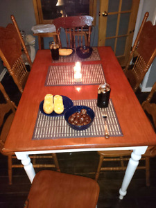 Solid red wood table and 6 chairs for sale