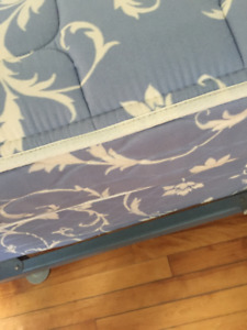 Twin bed box spring, mattress, and frame.
