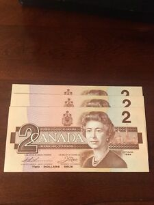 Three sequential serial numbered banknotes