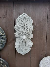 Stone leaf face orniments
