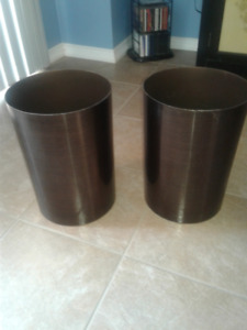 2 - Large, bronze color, garbage cans