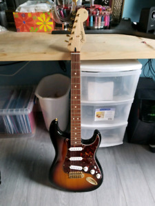 Various guitars for sale.