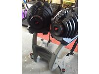 Bow flex Dumbells almost new condition, barely used with stand and safety straps