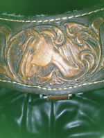 Beautiful leather breastplate with horse head engravings