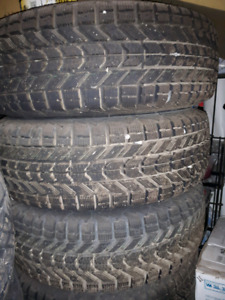 Four - 215/70/14 Firestone Winterforce ON Steelies