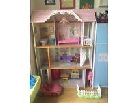 Kidikraft dolls house suitable for barbies