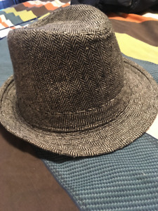 Black and white fedora and gray flower felt hats