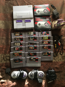 Used SNES with all controllers and cables, plus 17 games
