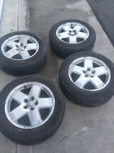 1 8'' Dodge mags with summer tires.