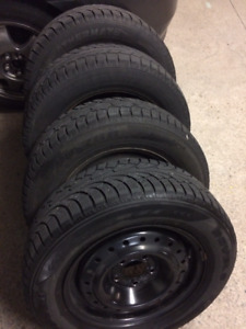 205/65 R15 Winter tires on steel rims.