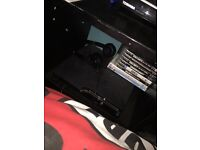 Black PS3 with accessories