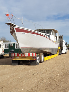 45 ft steel hull cruiser with truck and trailer