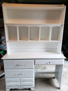 Desk with storage compartment