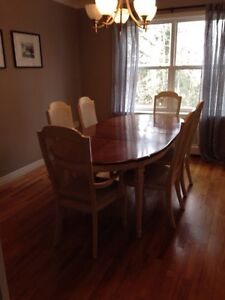 Beautiful walnut dining table and six chairs