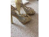 £10 high heels