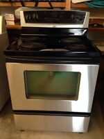 Used black and stainless whirlpool stove